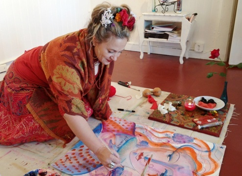 In 2013 artist and teacher Shiloh Sophia McCloud paints on the floor of her studio near Santa Rosa, California, U.S. Image: Jonathan Lewis